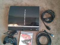Original PS3 40GB model with one controller, charging