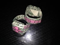 ONE DOLLAR BILL FOLDED INTO A RING WITH #1 PAINTED PINK