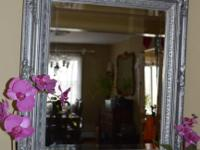 This very ornate vintage mirror in heavy wooden frame
