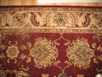 Ornate rug is a Nilipour style rug well kept and clean.