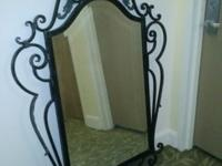 Large ornate mirror in antique finish metal. Mirror