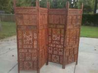 This appears to be a handcarved room divider has a