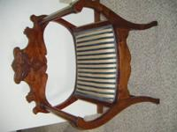 "Ornate chair Dark maple color 31"" high 25"" wide 15"""