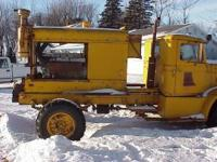 Oshkosh 4 wheel truck with a Snogo snow blower with a