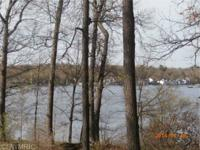 Buildable lot with a wonderful waterside view! Among