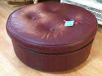 This ottoman is made in the U.S.A and has wheels. 2ft.