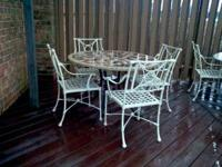 A nice out door patio furniture and several swimming