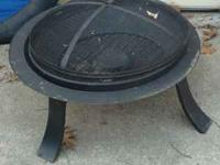 outdoor fireplace - $25; also grill, outdoor chairs,