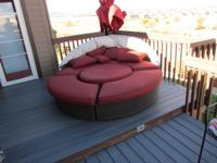 Red round outdoor lounger and umbrella used three