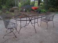 Outdoor metal table only, has thick glass top and hole