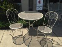 Vintage Woodard wrought-iron outside patio furniture.
