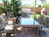 Outdoor patio glass table and 6 matching chairs