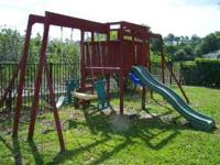 Wood outdoor play set with swings & slide in good