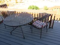 Round wrought iron table and four chairs E-mail: