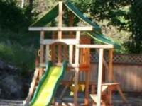 Outdoor jungle gym with two swings, one double swing,