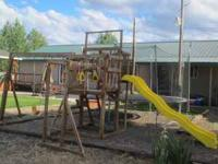 Play set is solid wood has 2 swings, slide, monkey bars