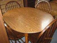 "Oval Shaped Dining Table That is 48"" x 36"". Has 4"