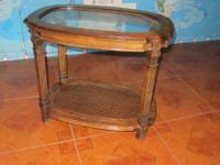 Oval glass top end table.