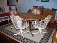 Oval Kitchen Table & 4 Chairs Table comes with a leaf