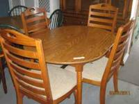 "Oval Shaped Red Oak Dining Table 48"" x 36"". Has 4"