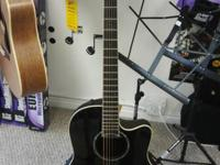 This is a used, but great playing Ovation Celebrity