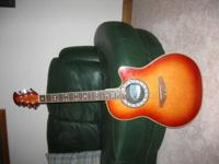 6-String acoustic with pickup and jack for hookup to an