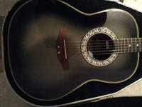 Offering an Ovation Ultra series 1312, includes case.