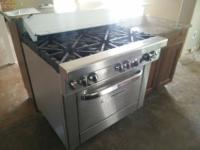 Commercial Grade style gas stove. It has 6 burners .