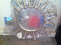 Sunburst mirror with an art deco vibe. Around 2-3 feet