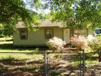 TWO HOUSES FOR SALE WITH JOINING FENCED YARDS. LOTS ARE