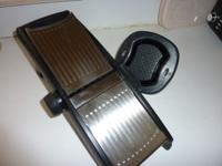 Mandoline slicer, by Oxo. Adjustable thickness.