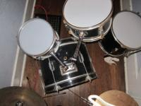 This is a used Pacific Mini drum set. I found this a