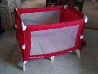 Fisher Price red & white pack n play. No tears or