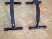 Padded push up bars in quality condition.. Cleaning out