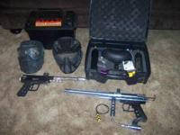 2 paintball guns, 2 masks, 2 7oz tanks comes with case