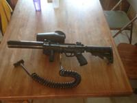 This paintball gun has barely been used. It is fully