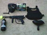 JT paintball gun that includes a paintball mask, barrel