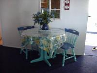 This is a cute dining set for a small area. The table