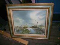 Small framed painting features beach scene with picket