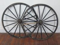 Wooden 16 spoke wagon wheels with some black paint and