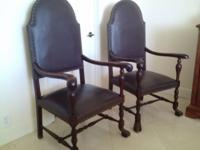 Handsome pair of hall armed chairs. Solid carved