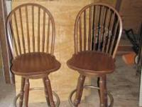 Pair of solid wood swivel bar stools in good condition