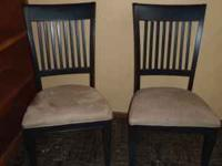 Pair of dark wooden chairs with suede seat covers. 17""