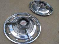 Nice set of two (2) vintage original SS Hubcaps. These