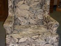 Pair of earth tone stripped wing back chairs. Chairs