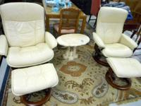 a pair of ekornes stressless recliners with ottomans in