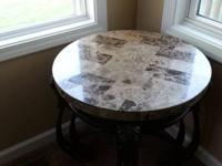 "Very heavy iron tables with marble tops. 25"" tall, 23"""