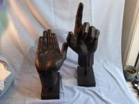 This is a pair (2) of hand sculptures made of cast iron