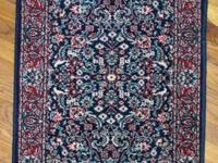 A pair of small oriental carpetings in tones of red,