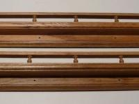 One pair of matching solid oak plate rails. Every one